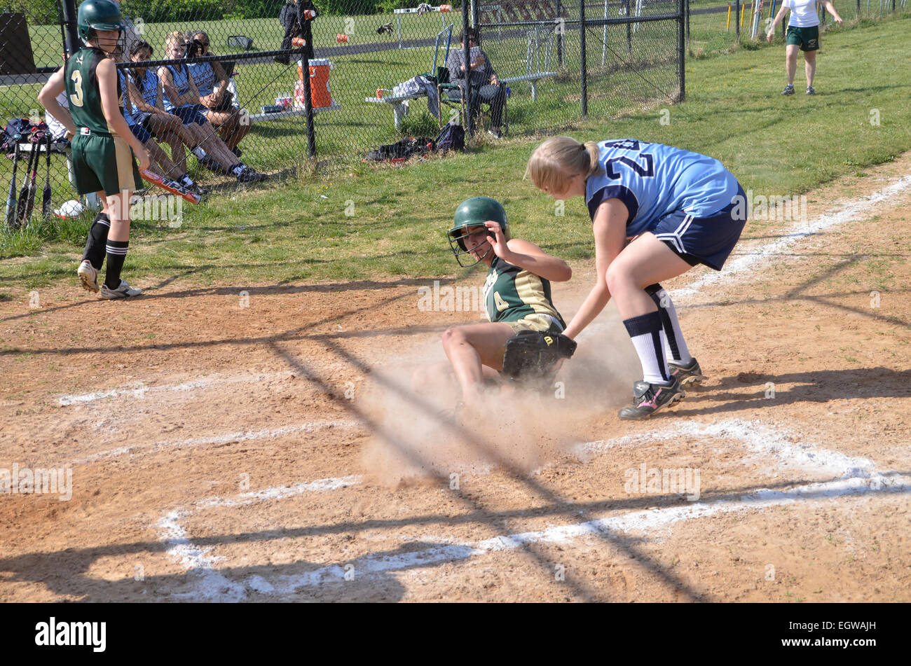 Girl tagged at home plate in a softball game Stock Photo