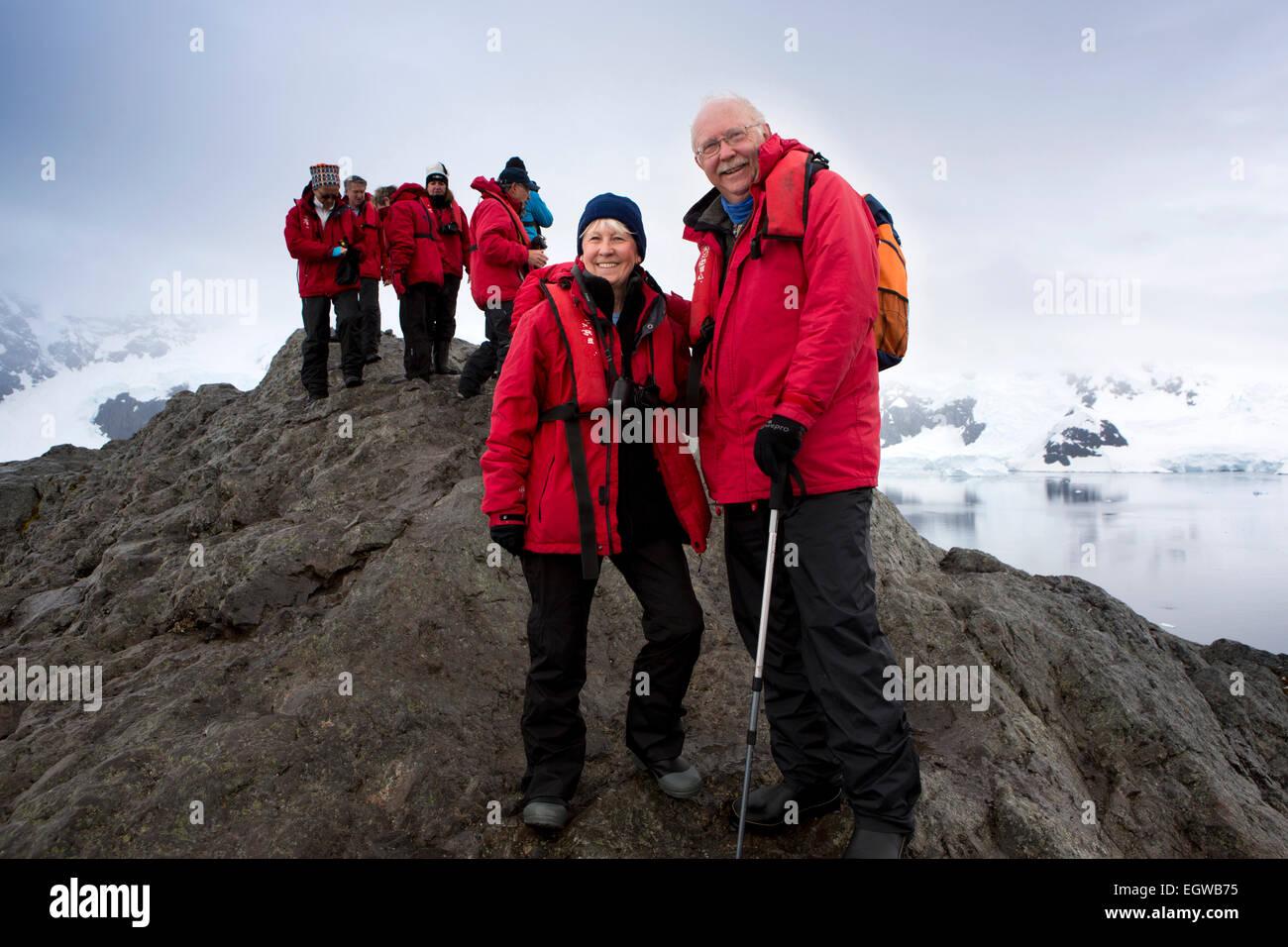 Antarctica, Graham Land, Paradise Bay, cruise ship passengers on top of viewpoint Stock Photo