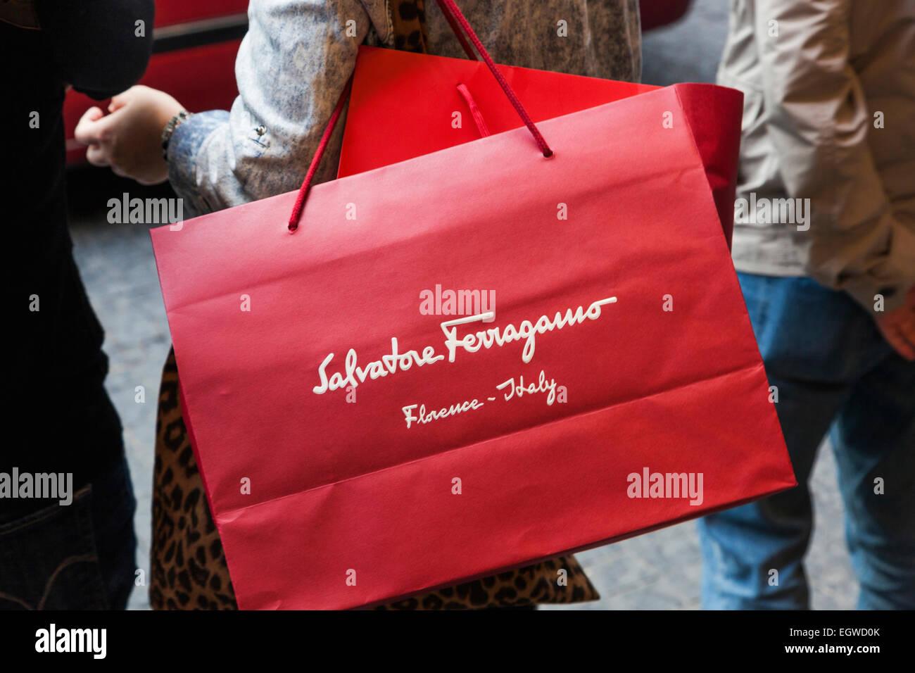 China, Hong Kong, Central, Shopper Carrying Salvatore Ferragamo Bag - Stock Image