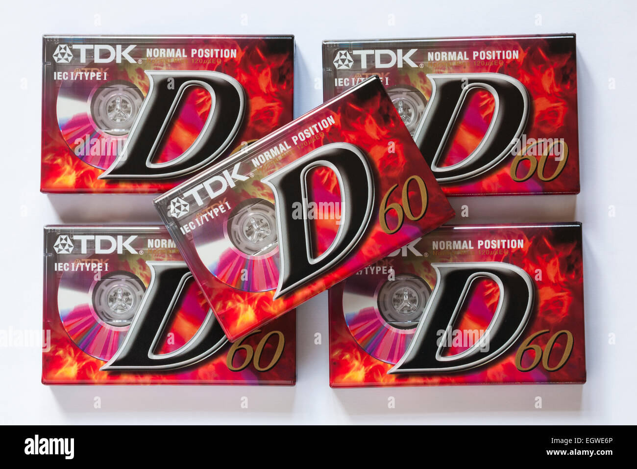pile of new wrapped TDK normal position D60 audio cassette tapes set on white background - Stock Image
