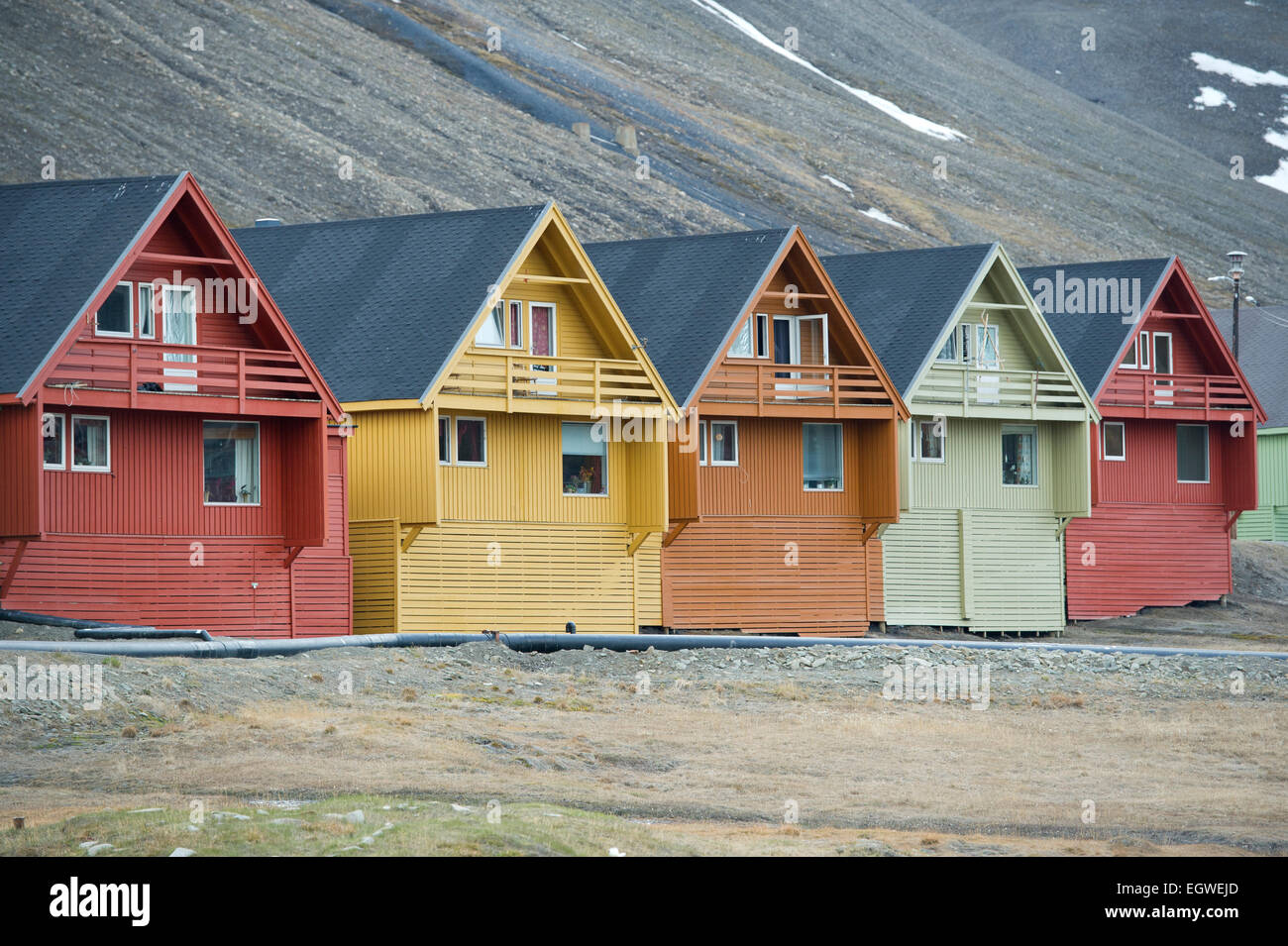 A row of colourful wooden Norwegian houses in the town of Longyearbyen on Spitsbergen, Svalbard - Stock Image
