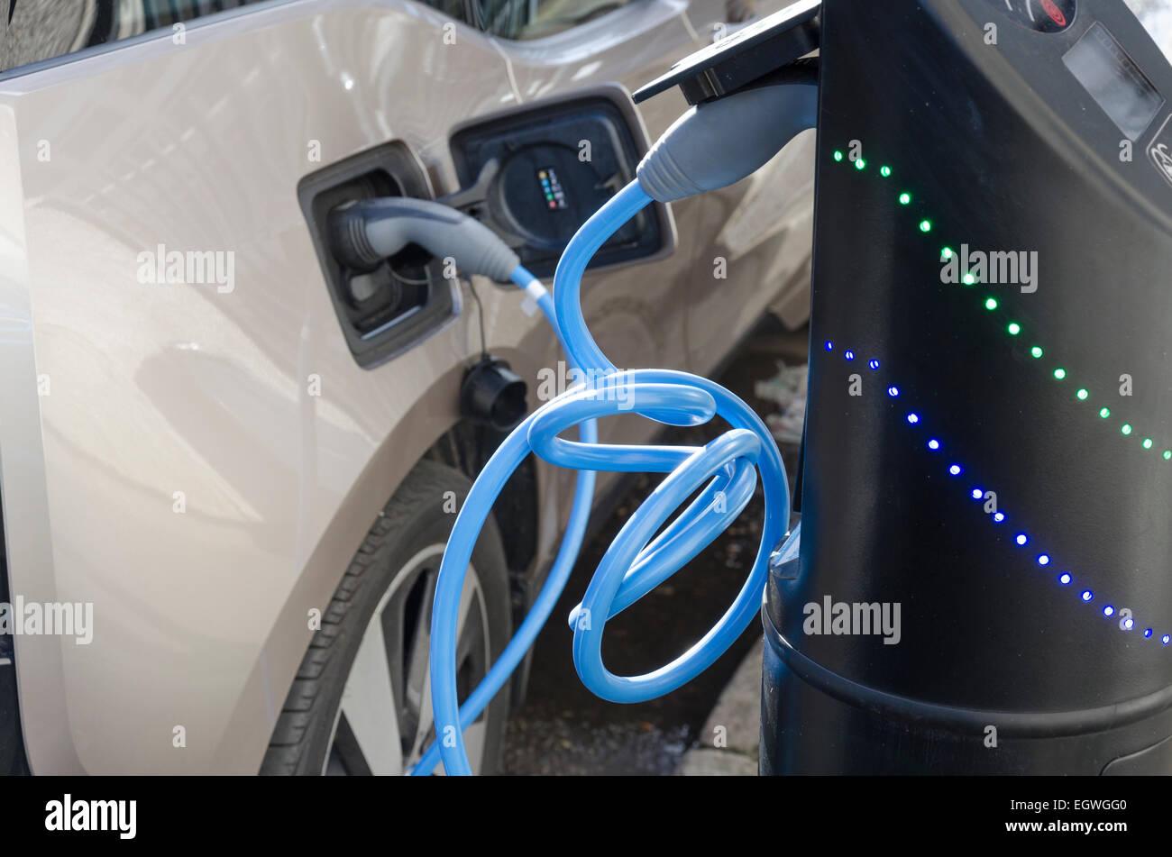 Electric car electric vehicle on-street charging. London, UK - Stock Image