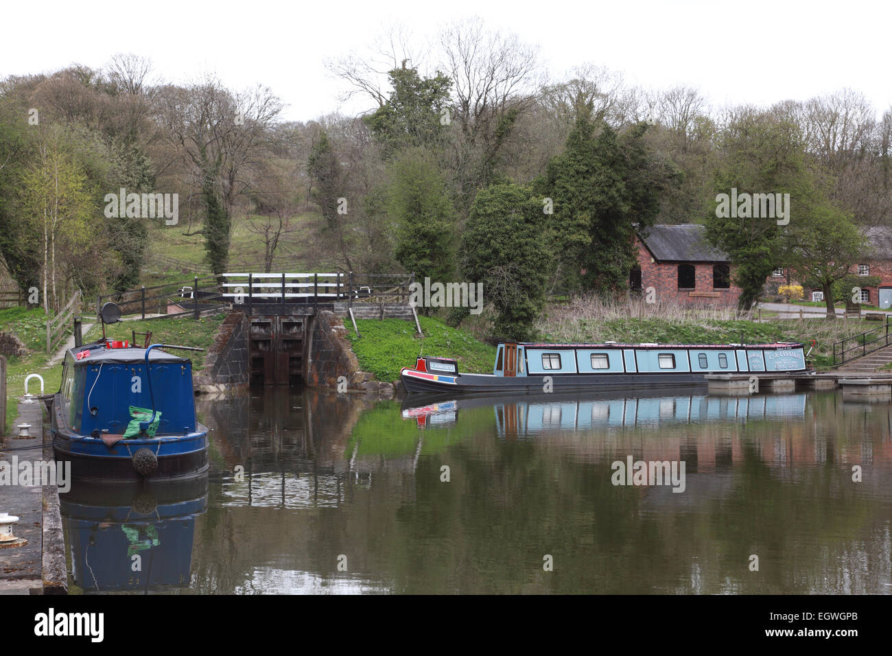 Narrowboats moored in Froghall Basin in Staffordshire at the end of the Caldon Canal, entered by a lock - Stock Image