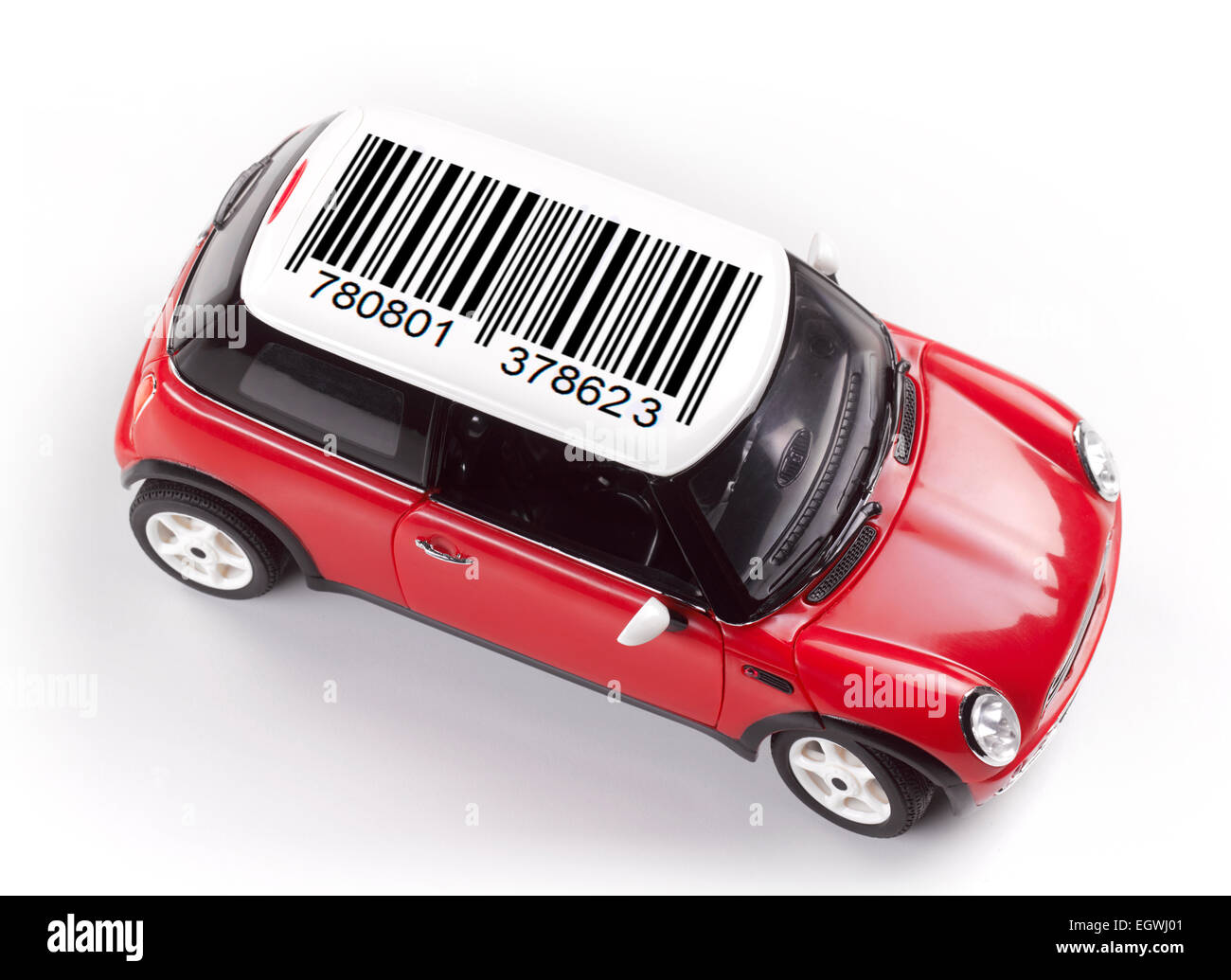 the cost of buying a car, cost of motoring, red toy , car shot from above on white - Stock Image