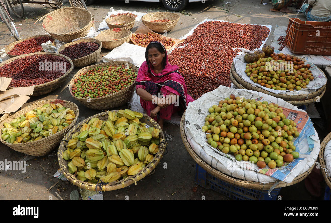 A women vegetable vendor waits for customers in a wholesale market at Kawran Bazar during a countrywide strike called Stock Photo