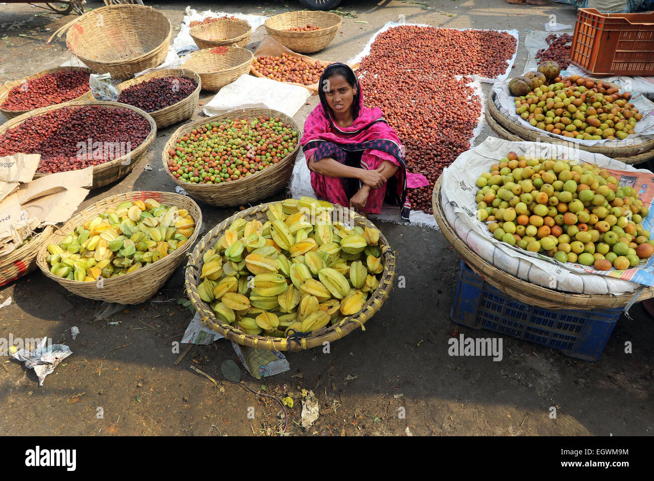 A women vegetable vendor waits for customers in a wholesale market at Kawran Bazar during a countrywide strike called - Stock Image