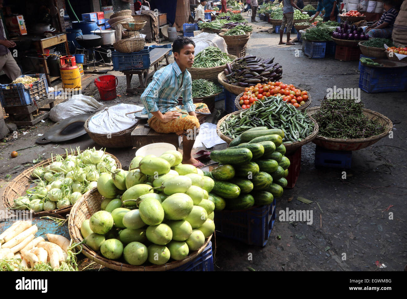 A vegetable vendor waits for customers in a wholesale market at Kawran Bazar during a countrywide strike called - Stock Image