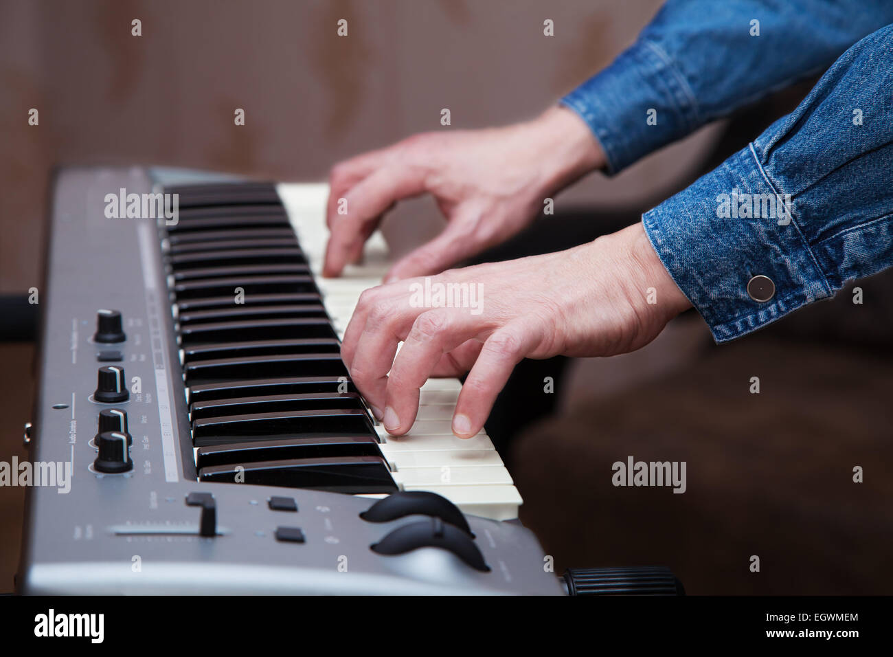 hands of the musician on the keyboard synthesizer - Stock Image