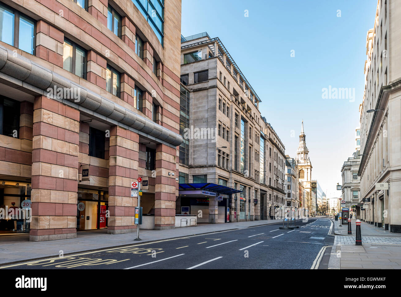 Views down Poultry in the City of London. 1 Poultry is on the left and St Mary le Bow church in the distance - Stock Image