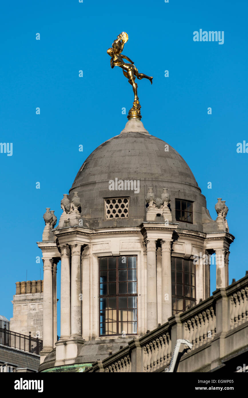 Shakespeare's Ariel, the spirit of air from The Tempest is a golden statue above the Bank of England over Tivoli - Stock Image