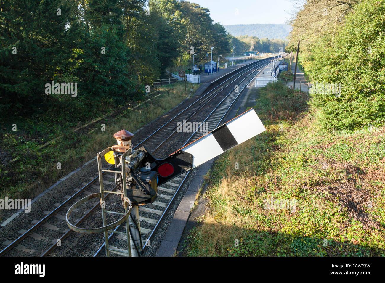 Railway signalling. Semaphore signal at clear, Grindleford Railway Station, Derbyshire, Peak District National Park, Stock Photo