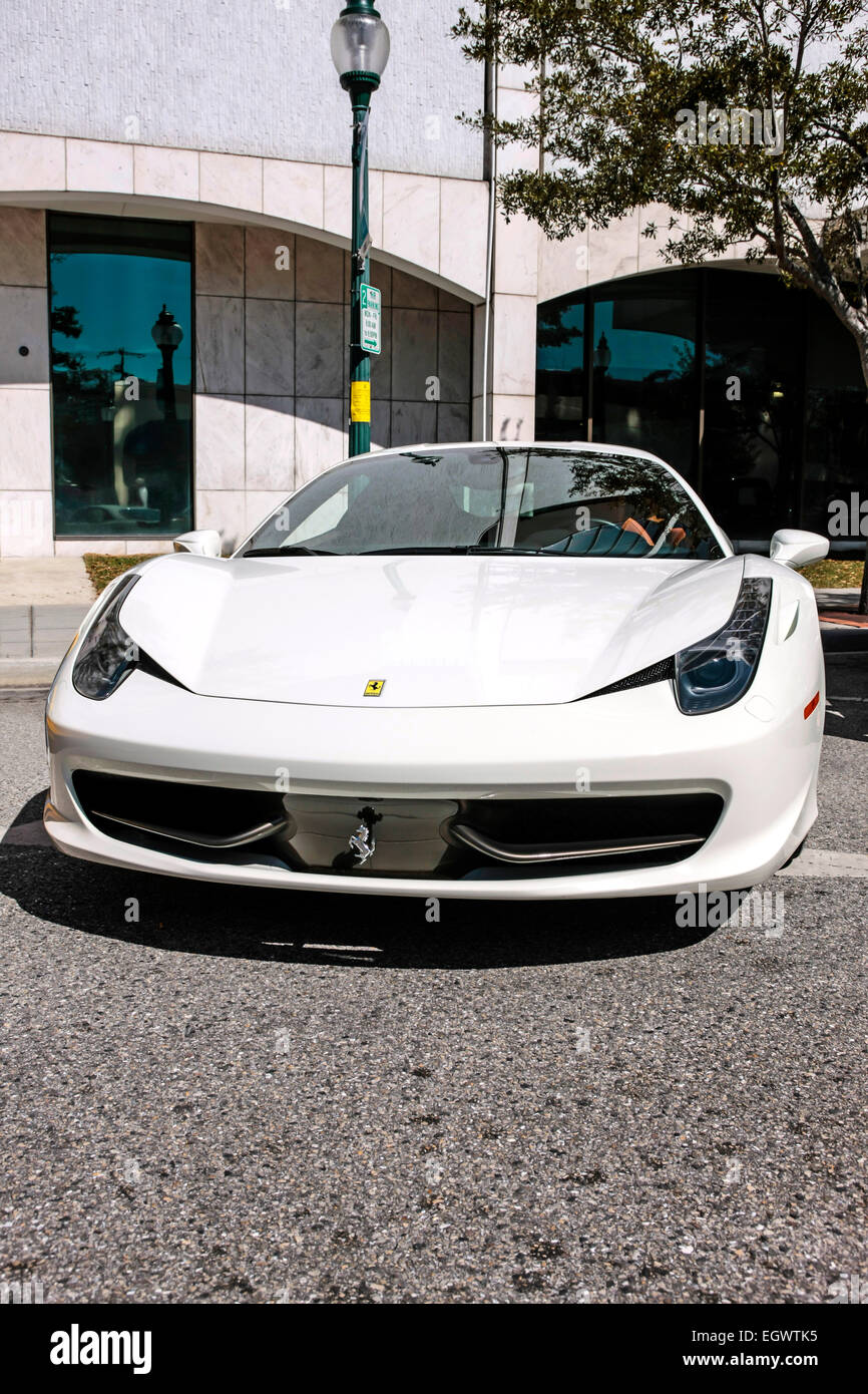 White Ferrari F458 Mid-engined sports car on Main Street in downtown Sarasota FL - Stock Image
