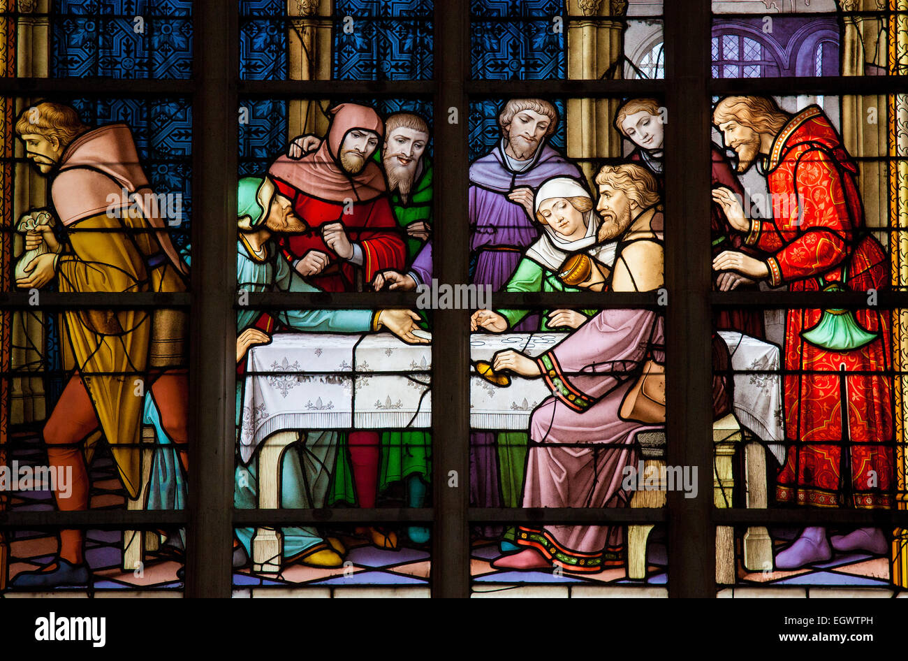 Stained Glass window depicting the antisemitic legend of Jews stealing sacramental bread, in the Cathedral of Brussels, - Stock Image