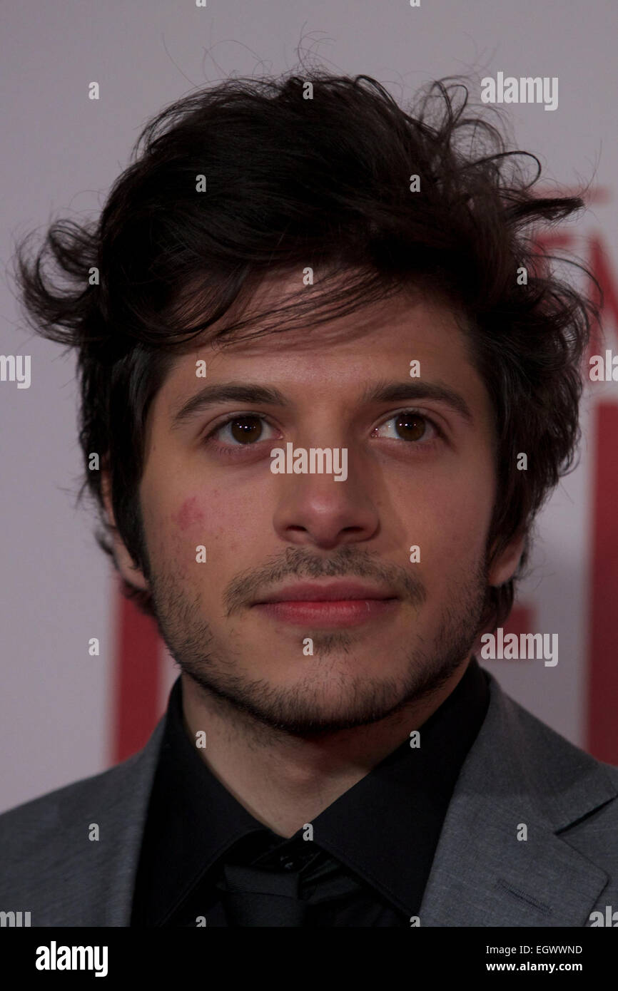UNITED KINGDOM, London : British actor Dimitri Leonidas poses on the red carpet as he arrives for the UK premiere - Stock Image
