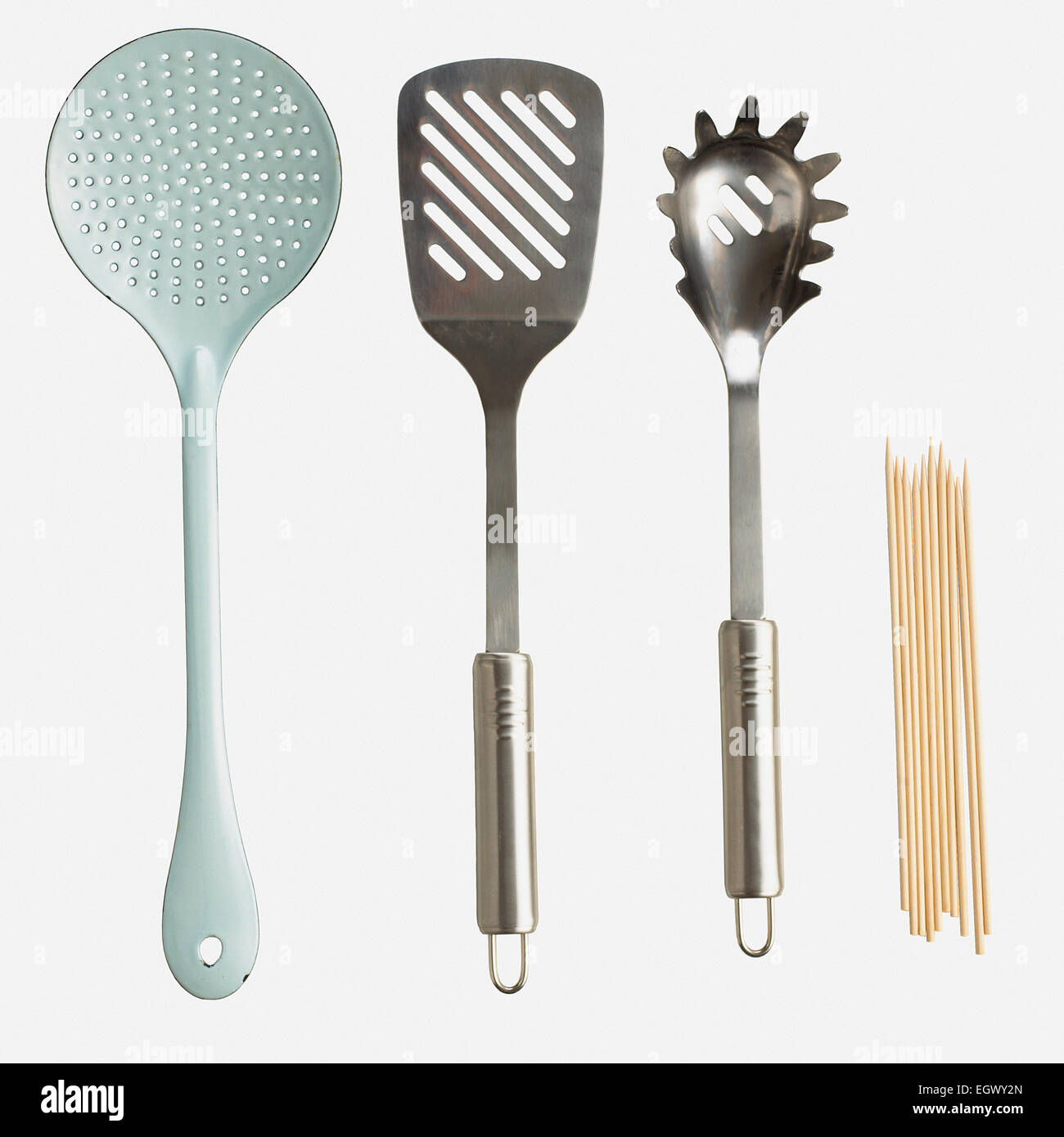 Slotted spoon, spatula, spaghetti claw and skewers - Stock Image