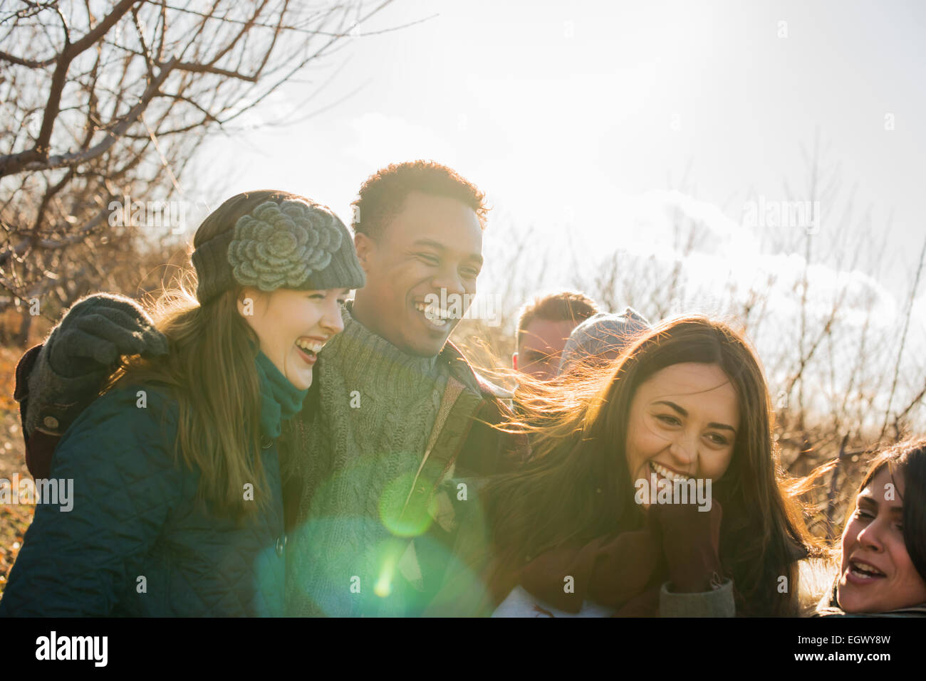 A group of friends on a winter walk. - Stock Image