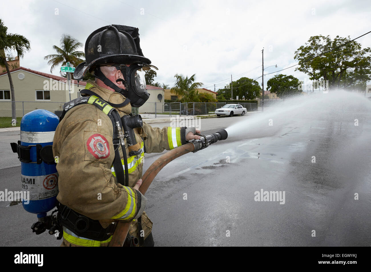 Firefighter with hose - Stock Image