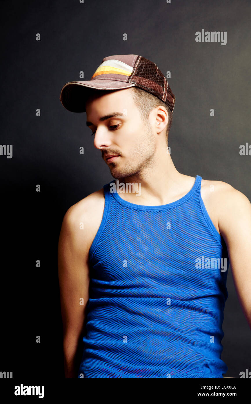 Man with Cap and String Vest in Studio - Stock Image