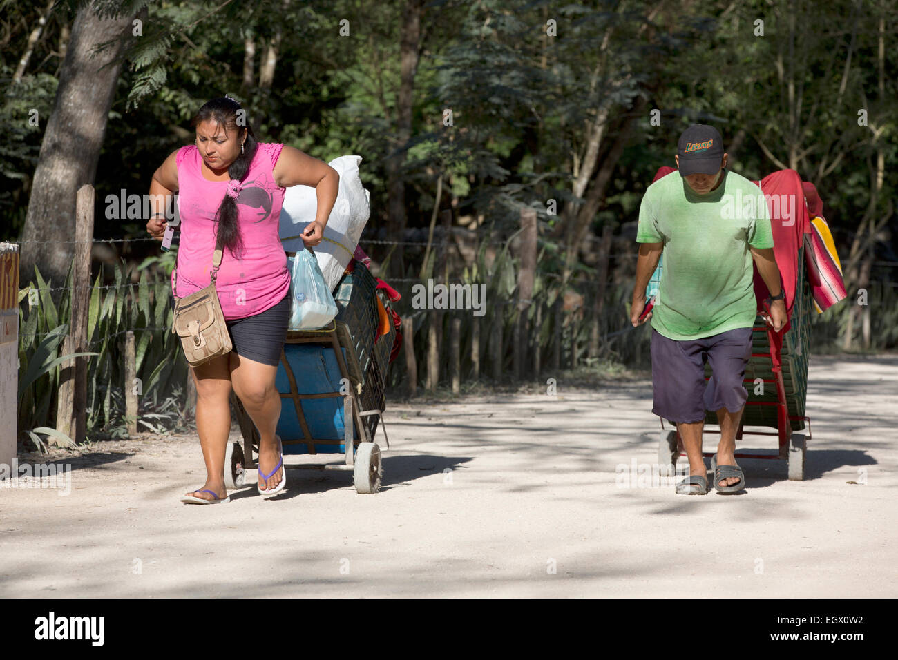 Souvenir vendors walking to set up their wares at Chichen Itza, Yucatan, Mexico - Stock Image