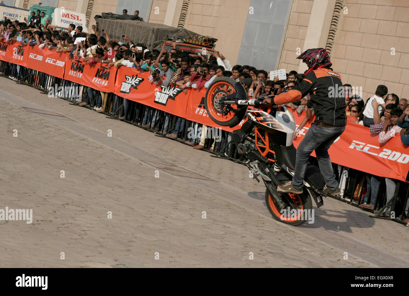 Motor cyclists KTM bikers perform stunts during the Hyderabad international auto expo on january 1,2000 in Hyderabad,India. Stock Photo