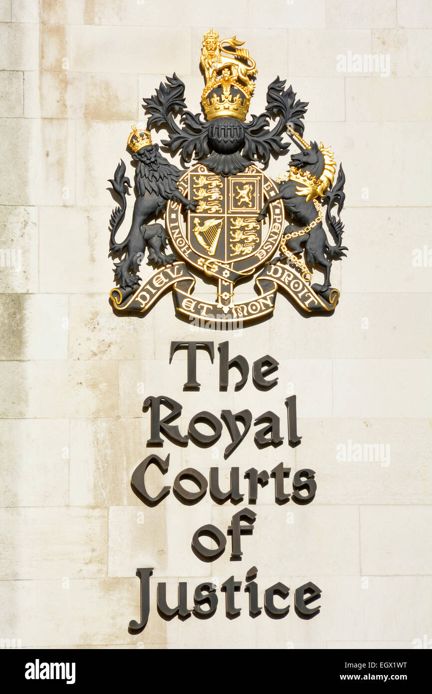 Royal Courts of Justice London & Royal Coat of arms of the United Kingdom as signs on the walls of the court building Stock Photo