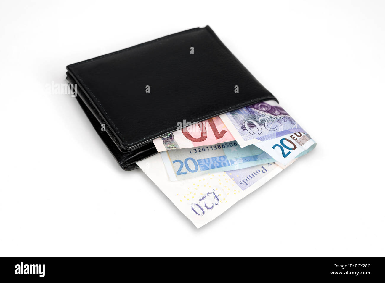 Wallet with euro and pound banknotes isolated over white with clipping path. Stock Photo