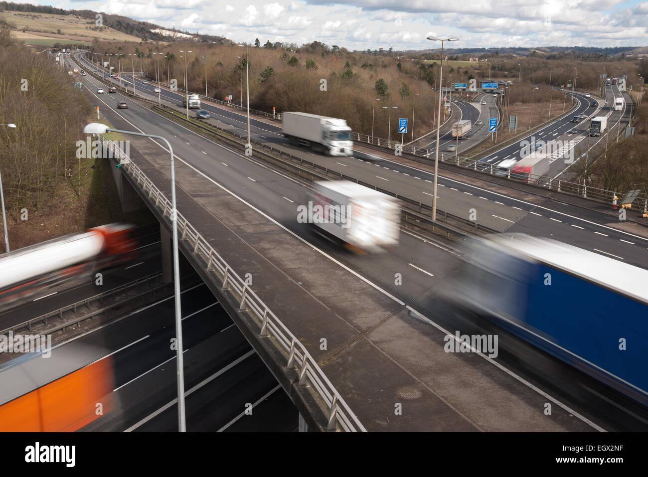 Free flowing motorway traffic at dual carriageway junction flyover bridge with lorries cars moving fast leaving - Stock Image