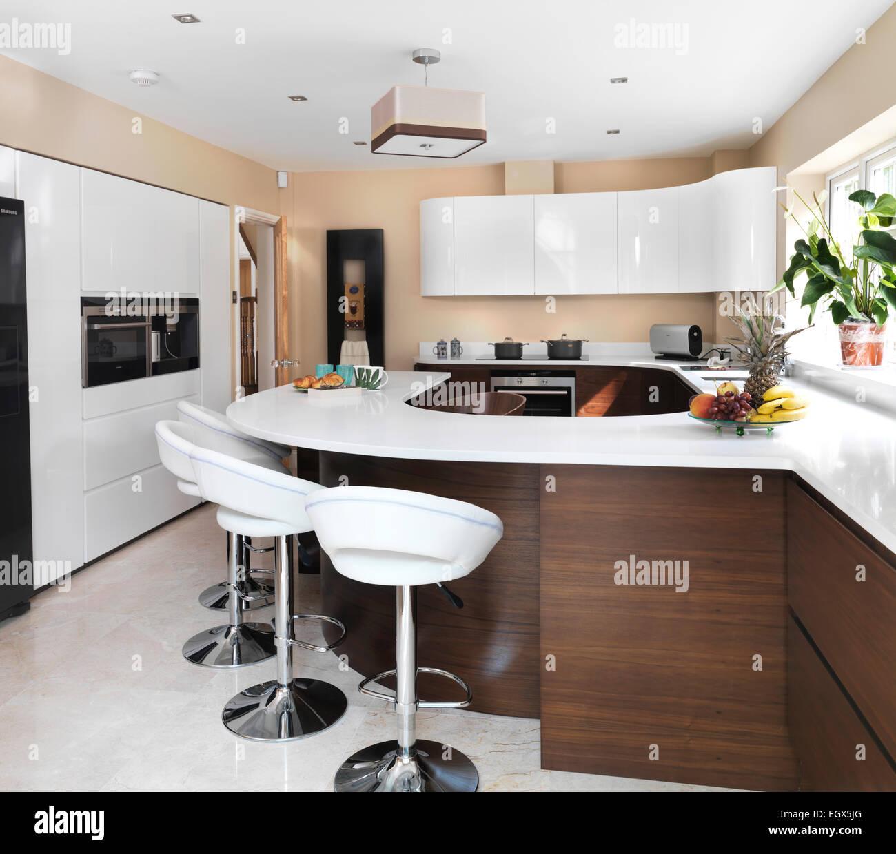 innovative design 12b22 8f829 Bar stools at breakfast bar in modern kitchen, UK home Stock ...
