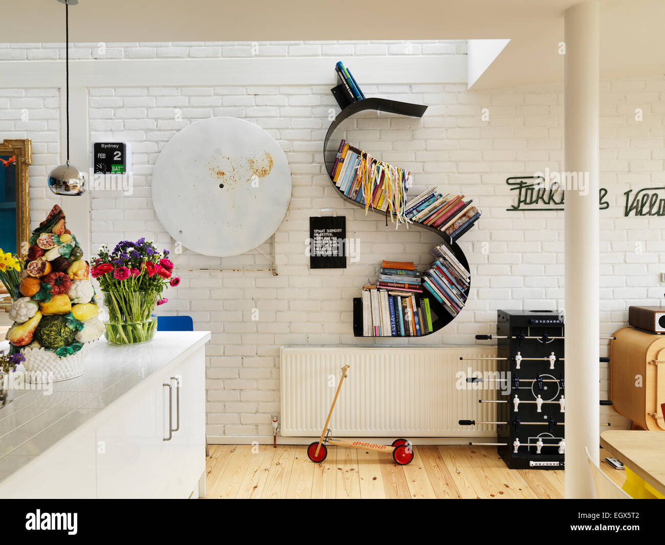 Kitchen With White Painted Brick Wall And Skylight Uk Home Stock Photo Alamy