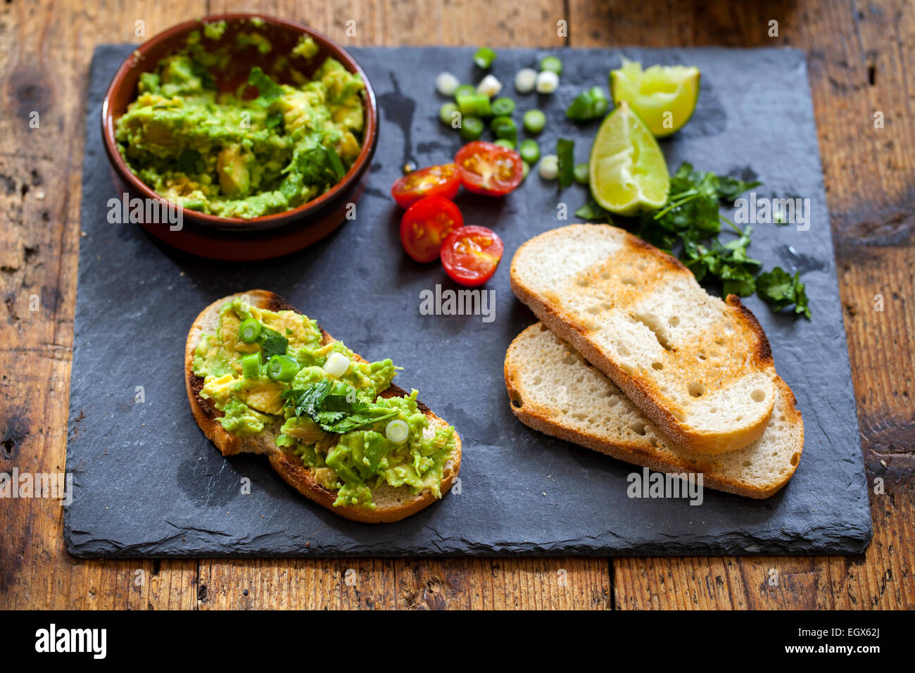 Canapes with avocado spread - Stock Image