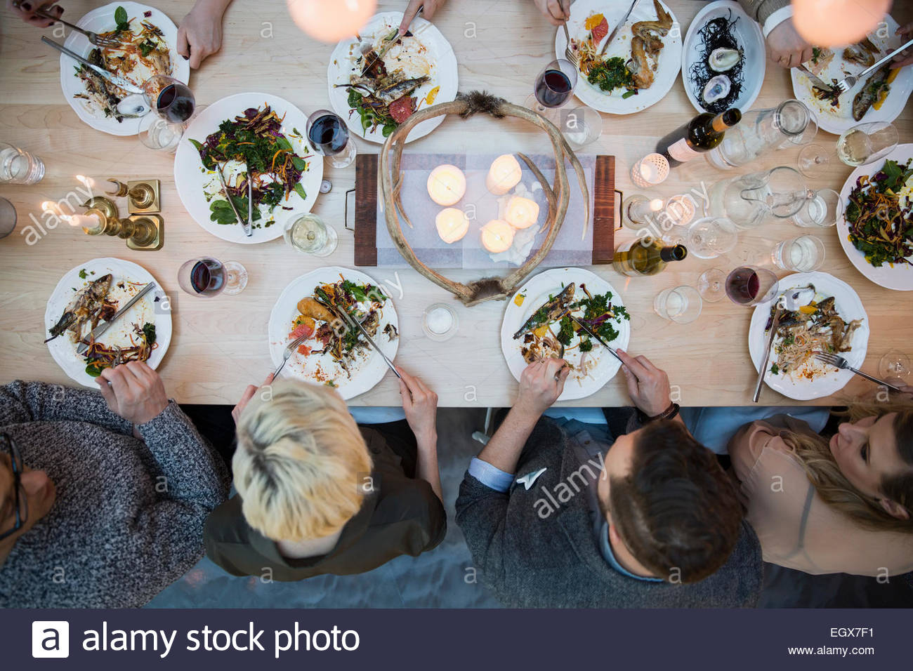 View from above friends eating at restaurant table - Stock Image