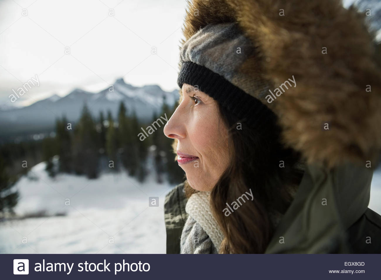 Close up of serious woman in fur hood - Stock Image