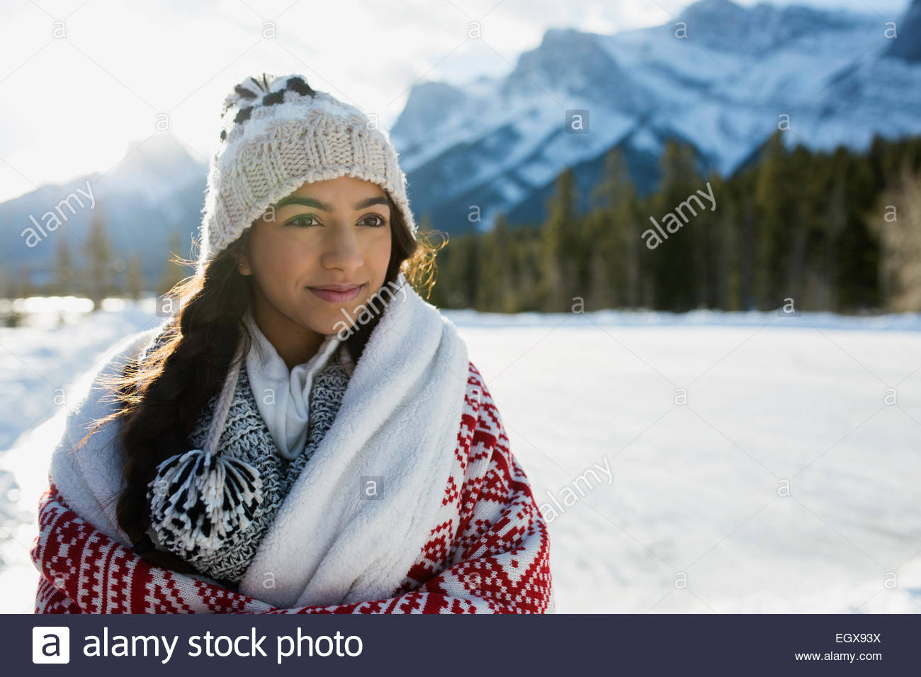 Smiling teenage girl in snowy field - Stock Image