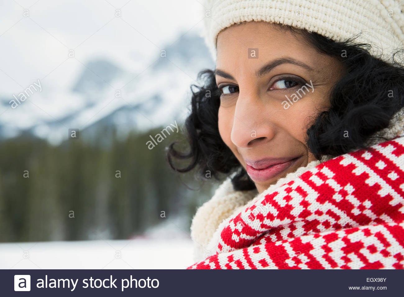 Close up portrait of smiling woman wearing scarf - Stock Image