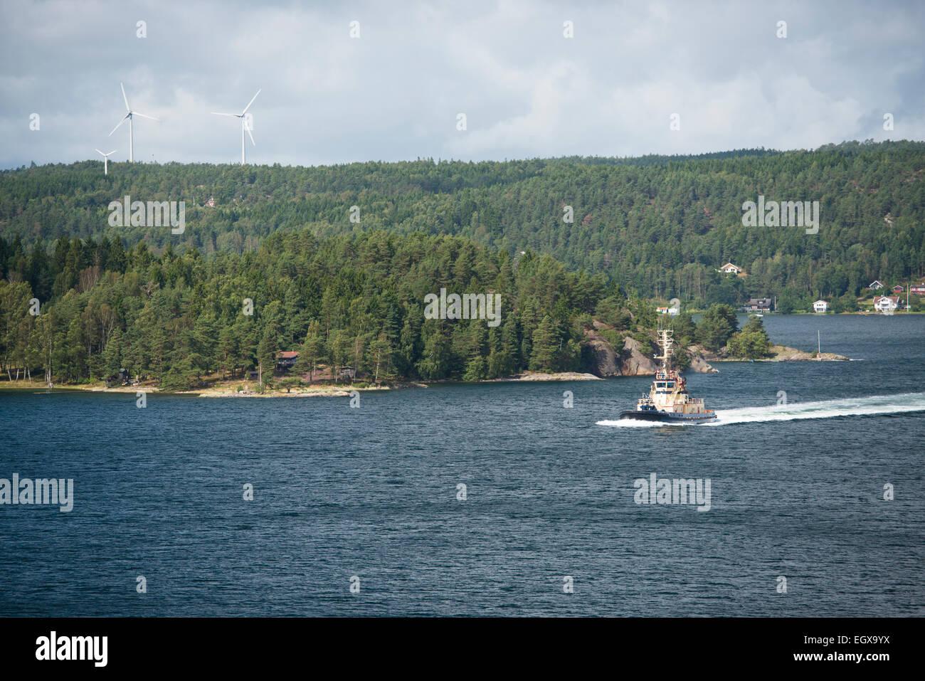 small boat in front of the island Orust, Västra Götalands län, Bohuslän, Scandinavia, Sweden - Stock Image