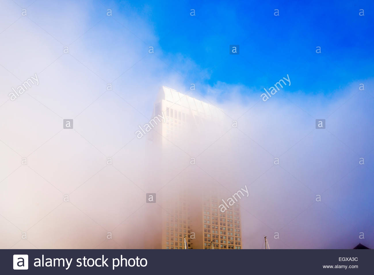 Fog partially covering a building at Embarcadero Marina Park. San Diego, California, United States. - Stock Image