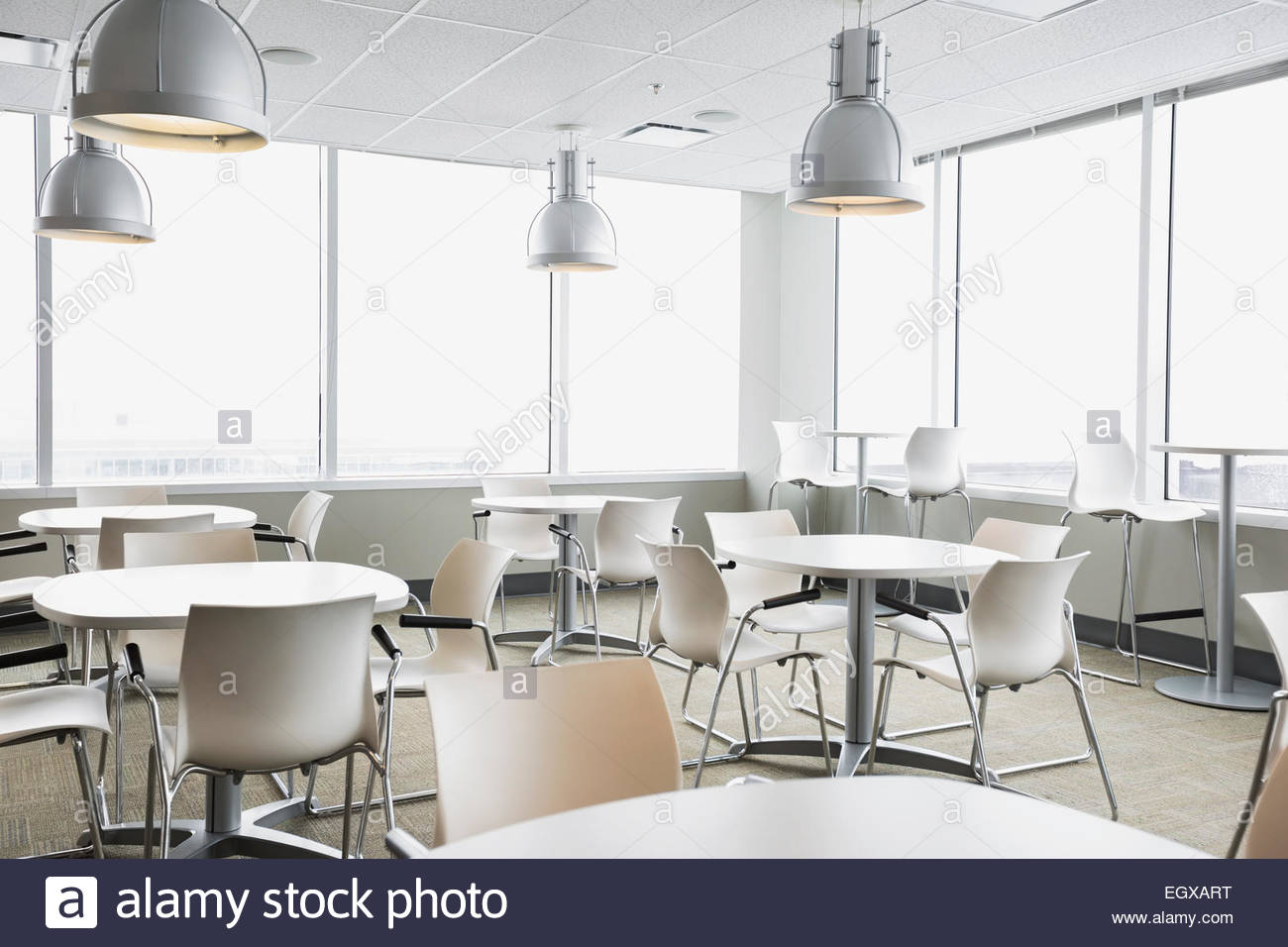 Empty white cafeteria tables - Stock Image