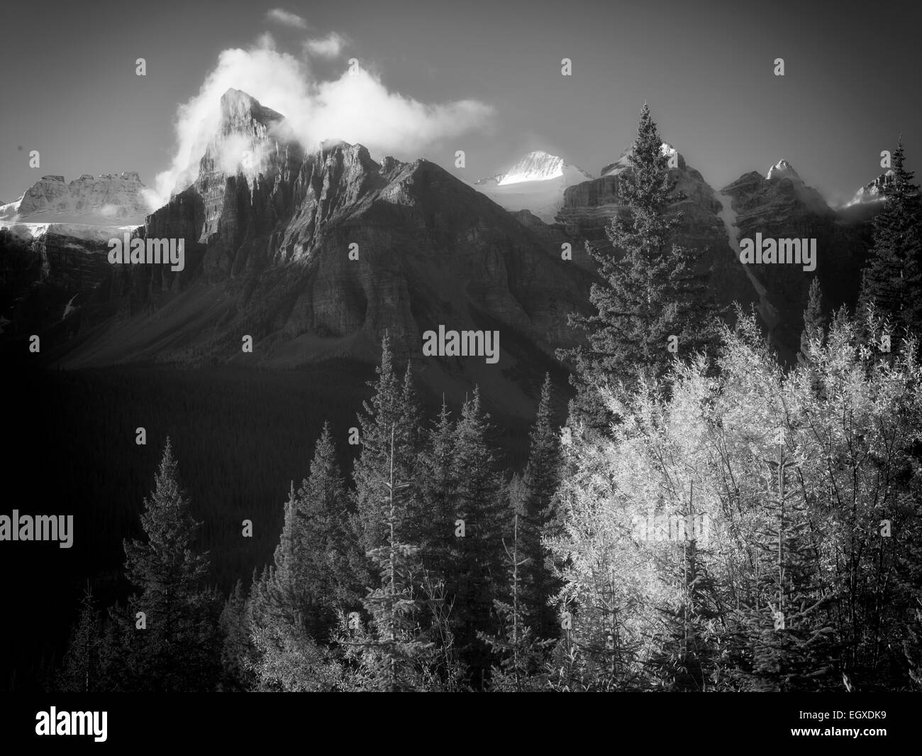 Early morning sunrise on peaks around Moraine Lake with fall color. Banff National Park. Alberta Canada. - Stock Image