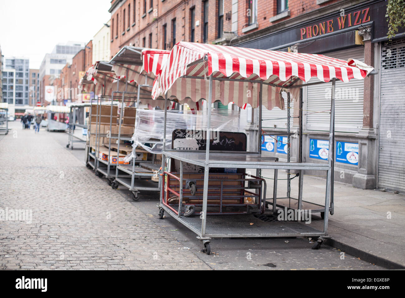 Stalls being set up on Dublin's Moore street on a Sunday Morning, Vintage tones - Stock Image