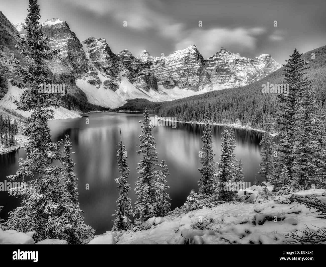 First snow of the season on Moraine Lake. Banff National Park, Alberta, Canada - Stock Image