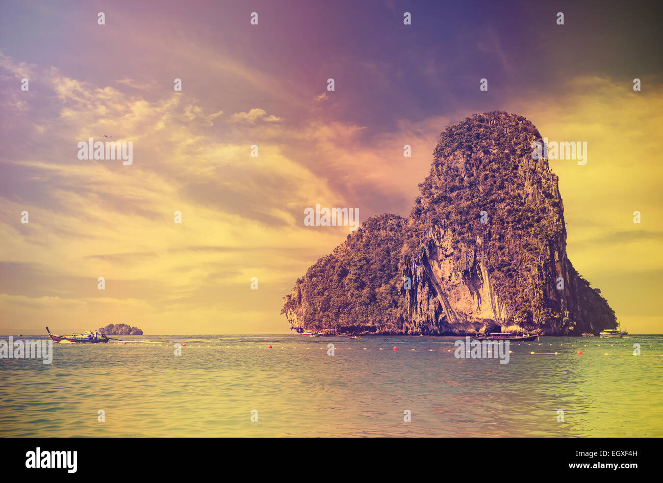 Retro vintage style filtered picture of an island at sunset. - Stock Image