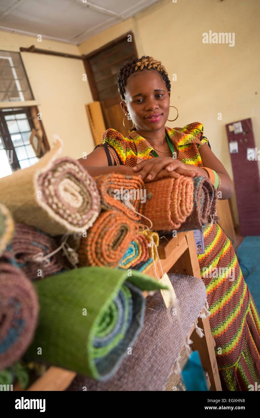 Sisal rugs on display in a handicraft workshop and retail store in Dar es Salaam, Tanazania, East Africa. - Stock Image