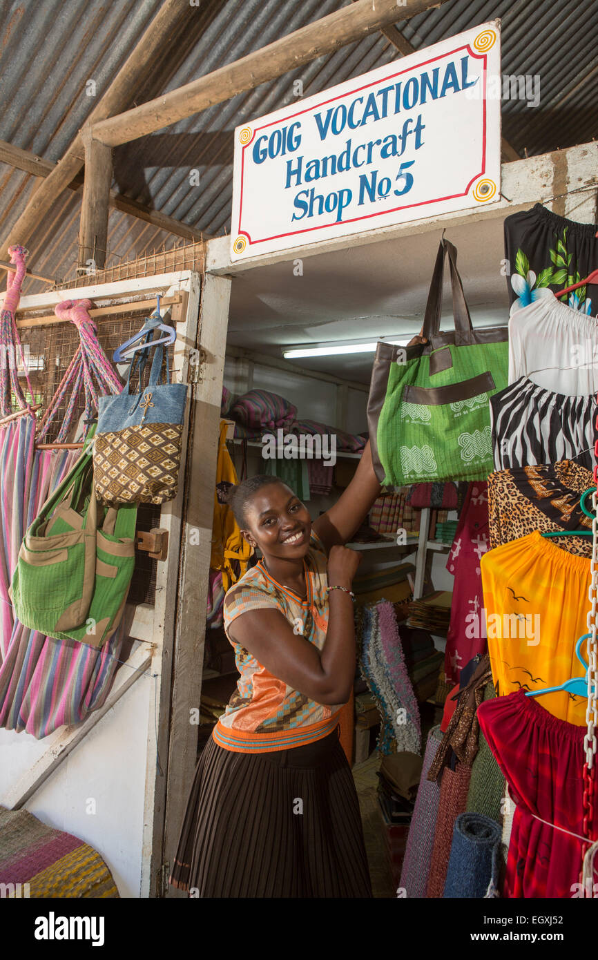 Handmade bags on display in a handicraft workshop and retail store in Dar es Salaam, Tanazania, East Africa. - Stock Image