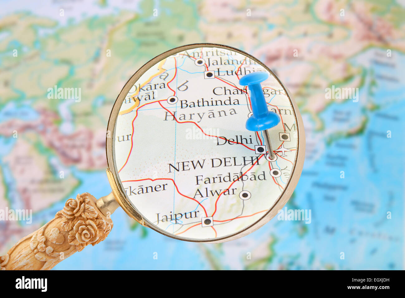 Blue tack on map of the world with magnifying glass looking in on blue tack on map of the world with magnifying glass looking in on new delhi india gumiabroncs Gallery