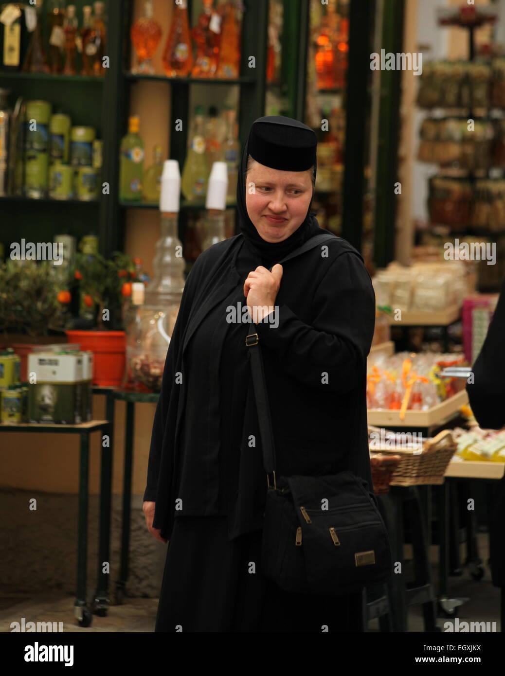 Orthodox nun, Corfu Town Corfu. Nun in black habit - Stock Image