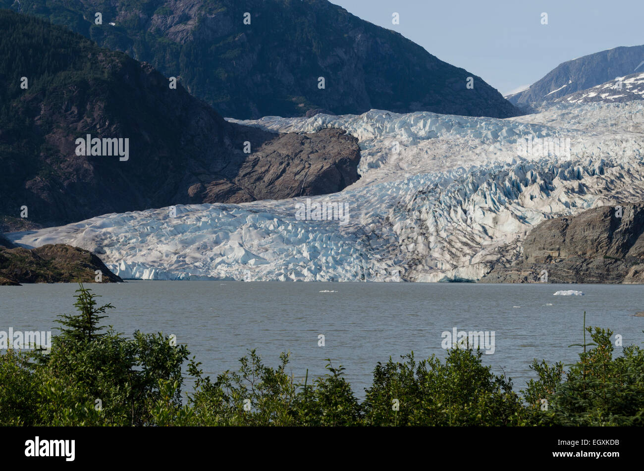 Mendenhall Glacier is a tidewater glacier terminating in Mendenhall lake some 16 miles from downtown Juneau, Alaska's - Stock Image
