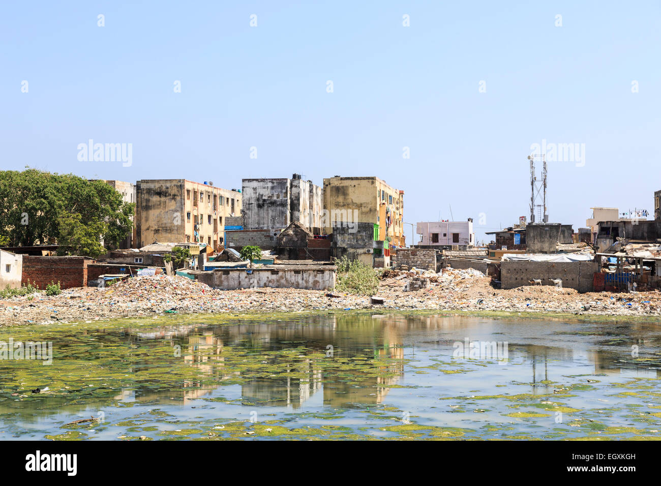 Third world poverty lifestyle: Poor riverside slum tenements on the banks of the polluted Adyar River estuary in - Stock Image