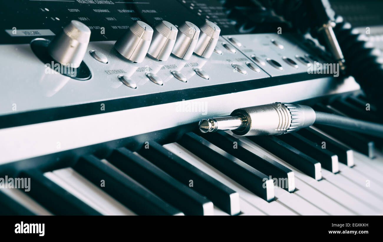 An electronic keyboard and audio jack lead shot with a shallow depth of field. Stock Photo