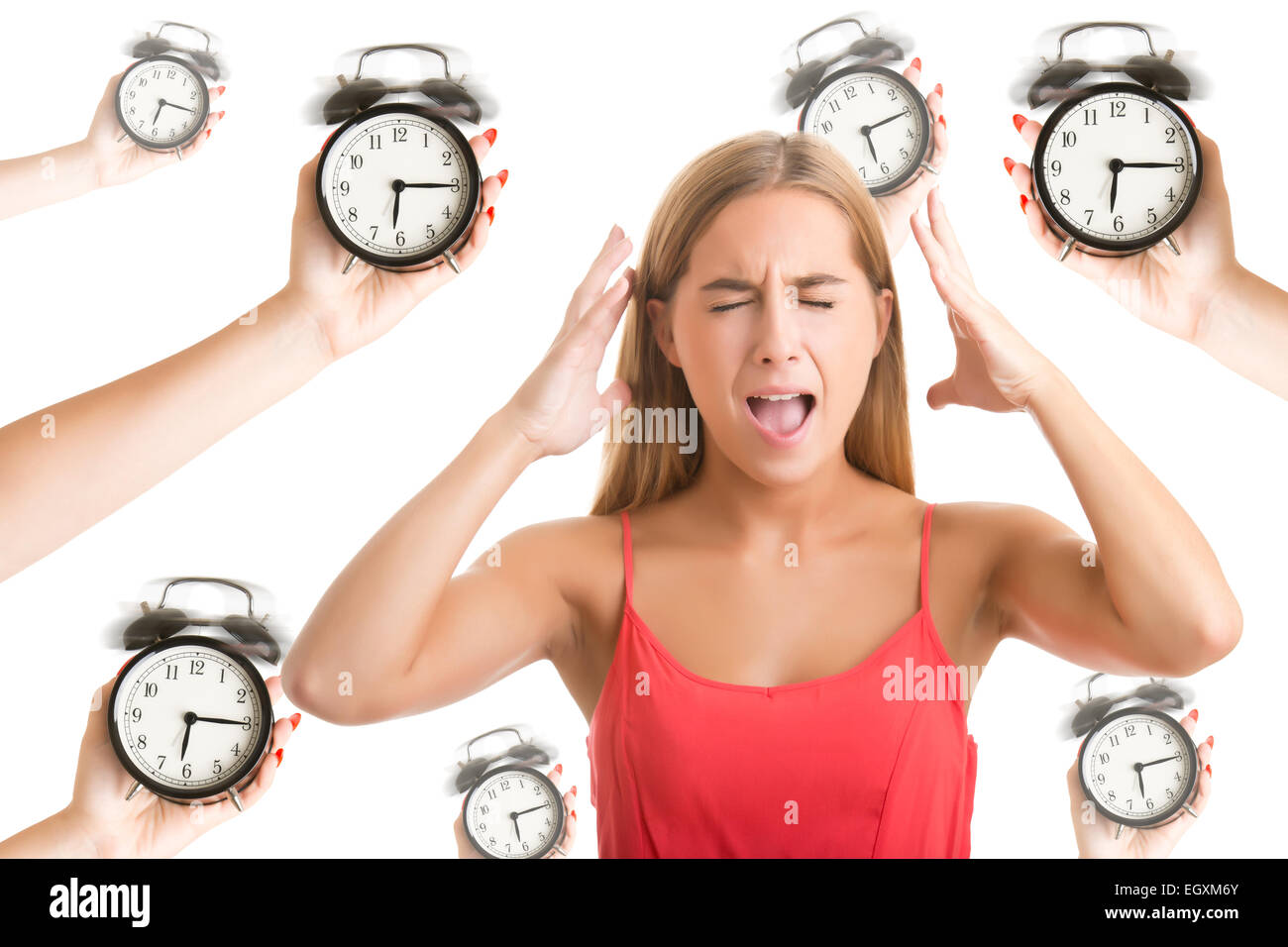 Woman suffering from a nervous breakdown, holding her hands to her head, with alarm clocks around her, isolated - Stock Image