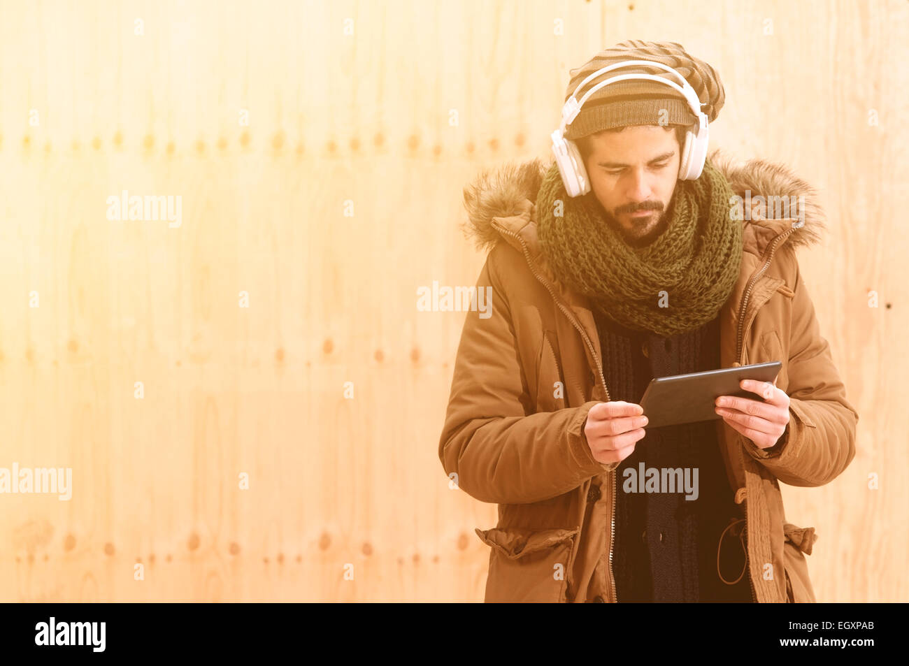 a young man listens to music in an urban image of modern life istagram style toned Stock Photo